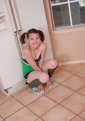 Cute redhead Kir in pigtails and knee socks strips down