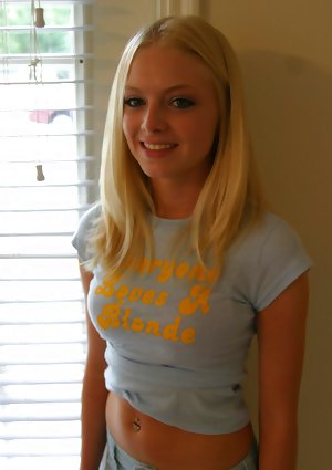 Blondy amateur Skye Model models by herself in a short skirt