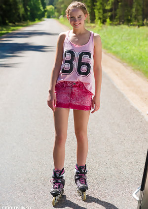 Young blonde girl Faina gets naked in middle of road wearing roller blades