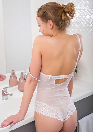 Adorable young Faina Bona strips white sheer lingerie to show closeup pussy