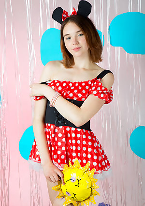 Petite young girl poses in the nude wearing Minnie Mouse ears only
