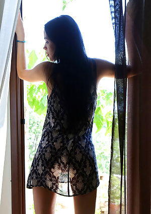 Exotic young looking Venice Lei is ready for exposed posing after her morning coffee