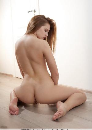 Sexy redhead Nika K showcases her shaved vagina