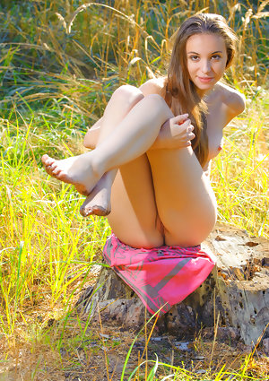 Young solo girl Nensi A heads into marshy ground to model in the nude