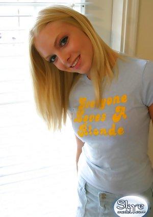 Blonde amateur Skye Model models by herself in a short skirt