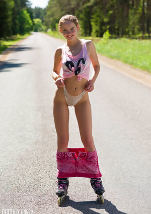 Youthful blondhaired lady Faina gets without clothes in middle of road wearing roller blades