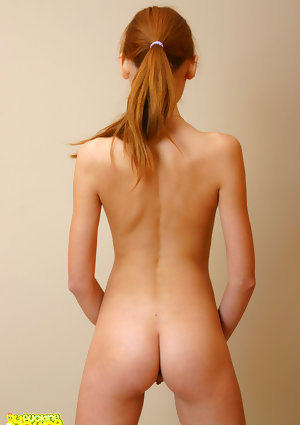 Attractive carroty postures her lovely adolescent figure in the naked all by herself