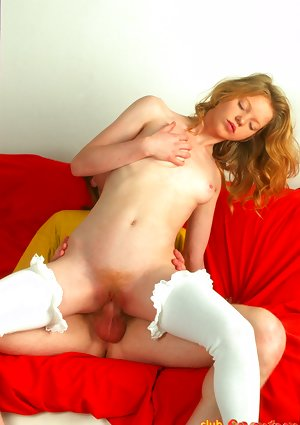 Young redhead in white stockings rides a cock until an open mouth facial