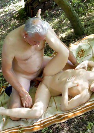 Young slut is spanked by her daddy before they fuck in the woods
