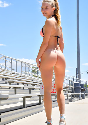 Fit blonde Angelina exposes her ass in public before naked cartwheels on road