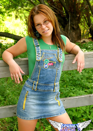 Erotic cutie Kandie in bib skirt flashes cotton panties upskirt in the grass