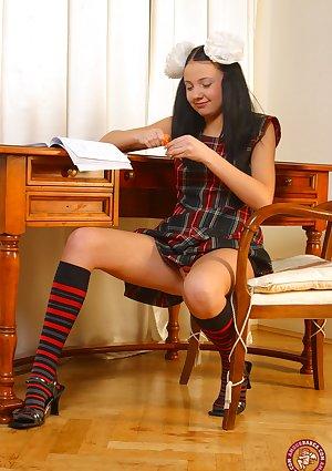 Cute teen Belinda removes plaid schoolgirl attire before masturbating