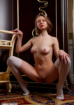 Young looking girl Jenny confidently poses naked in white stockings