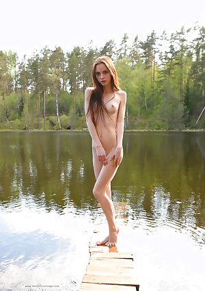 Slender teen with long legs Lapa models totally naked at the lake