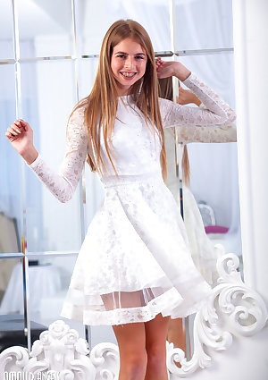 Young looking girl Rina takes off her pretty dress to model totally naked