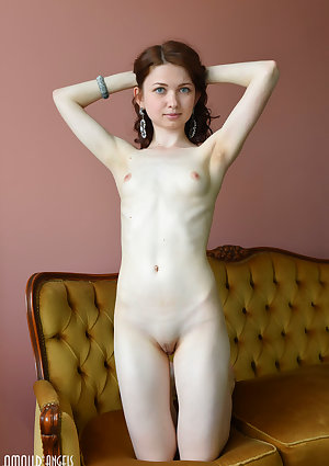 Babe with petty tits Lusia posing backside bare on the sofa