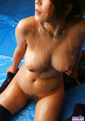 Japanese girl with nice tits and a trimmed bush is covered in sperm