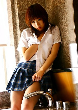 Japanese teen Hina Tachibana sinks her underwear attired body in bathtub