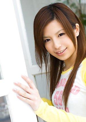 Adorable Japanese girl Riri Kuribayashi exposes her trimmed pussy
