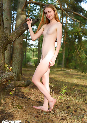 Rangy adolescent Malinka poses her slender figure in the without clothes at a camping site