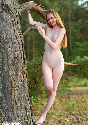 Leggy teen Malinka shows off her thin body in the nude at a camping site