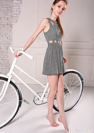 Skinny teen removes her dress after cycling to stand totally naked