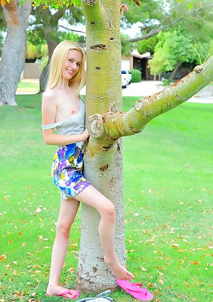 Very skinny blonde cutie Kennedy gets completely naked in public