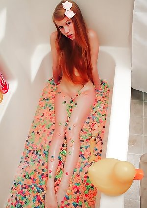 Dolly Little bathing in fruit loops