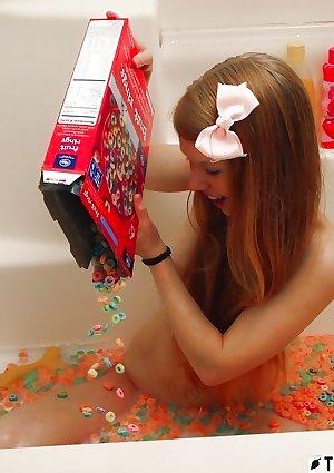 Dolly Little bathing in fruit loops