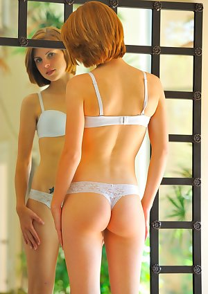 Teen girl Aubrey Belle posing in her white lingerie