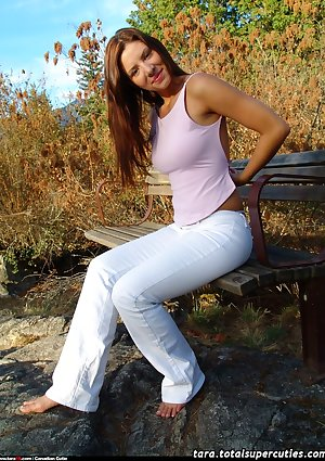 Brunette teen with heavy tits poses full nude on a bench