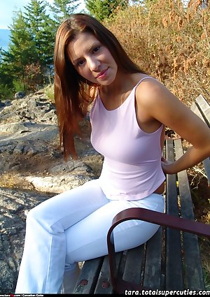Darkhaired teenager with heavy titties postures full exposed on a bench