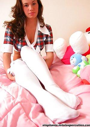Stephanie in her bedroom in short skirt and white stockings