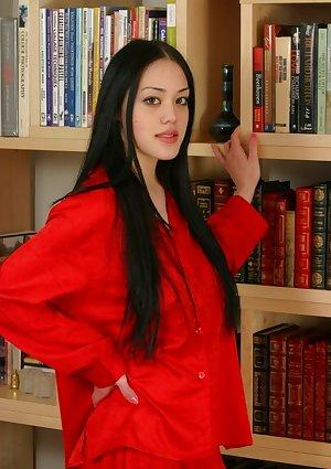 Sophisticated oriental teen poses in panties