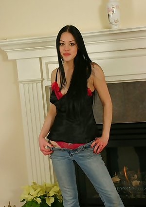 Alice undressing by the fireplace