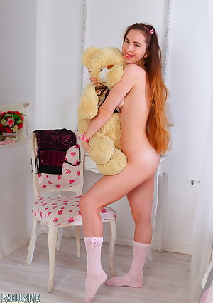 Adorable teen Bella ditches her tutu and panties to pose nude in socks