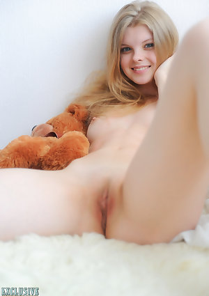 Young looking adolescent Kisa strikes beguiling naked modeling by doing holding a teddy bear