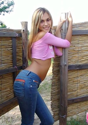 Slender sexy blonde teen in tight jeans & belly shirt posing clothed outdoors  Amateur Outdoor Teen blonde outdoors tight babe sex