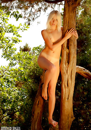 Angelic blonde teen naked outdoors with her tiny tits on display