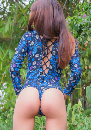 Skinny teen Mily Mendoza bends over naked outdoors to show a perfect tiny ass